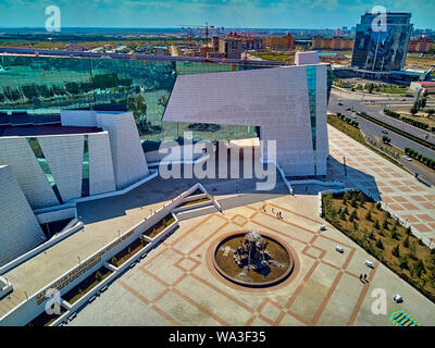 NUR-SULTAN, KAZAKHSTAN (QAZAQSTAN)- August 11, 2019: Beautiful panoramic aerial drone view to Nursultan (Astana) city center with skyscrapers and Nati - Stock Photo