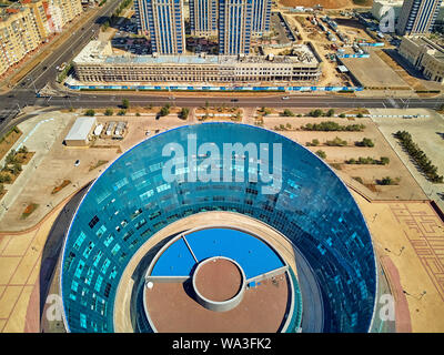 NUR-SULTAN, KAZAKHSTAN - August 11, 2019: Beautiful panoramic aerial drone view to Nursultan (Astana) city center with skyscrapers and Shabyt Palace o - Stock Photo