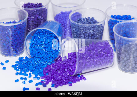 some blue and violet dyed thermoplastic resin on white background - Stock Photo