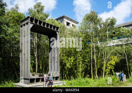 Heritage Park with original box girder section of old iron tubular Britannia rail Bridge before fire on display beside repaired bridge. Bangor Wales - Stock Photo