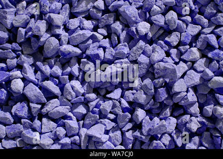 violet dyed stones for background texture in the sun - Stock Photo