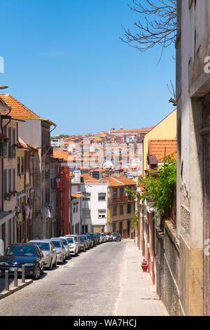 Portugal Vila Nova de Gaia street scene panorama Porto Oporto buildings houses cars balconies - Stock Photo