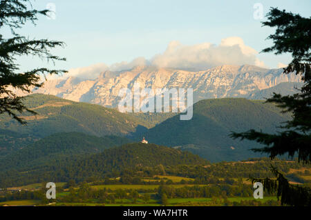 View of Sierra del Cadí mountain range and Sant Antoni del Tossal chapel from La Seu d'Urgell (Alto Urgel, Lleida, Pyrenees, Cataluña, Spain) - Stock Photo