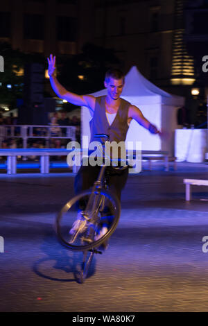 7th July 2019. Young man doing acrobatics on a bicycle at Parade of Entertainers during 32nd ULICA Street Theatre Festival in Cracowyoung - Stock Photo
