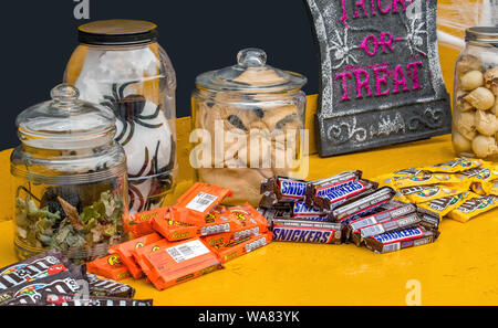 October 27, 2018 Coloma MI USA; candy bars are set out next to spooky things in jars, for trick or treat during a Halloween event in a small Michigan - Stock Photo