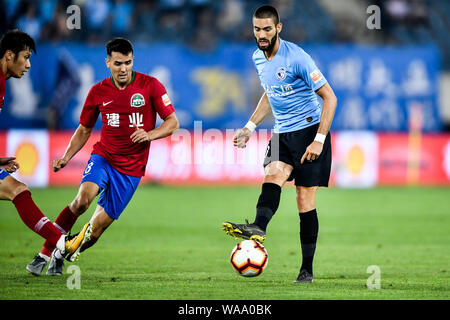 Belgian football player Yannick Ferreira Carrasco, right, of Dalian Yifang passes the ball against English-born Taiwanese football player Tim Chow of - Stock Photo