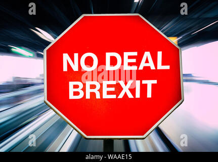 No Deal Brexit written on octagon stop sign with blur zoom in background. Sense of urgency at upcoming October 31st, 2019 deadline - Stock Photo