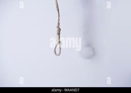 Gallows hanging rope knot tied noose white isolated - Stock Photo