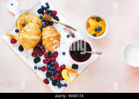 Fruity breakfast. Breakfast with freshly baked croissants, fresh summer berries and honey. Top view, blank space - Stock Photo