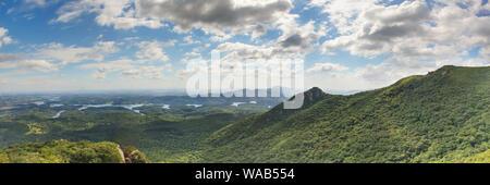 Panorama from on top of Parana's coastal mountain range overlooking the lush Brazilian landscape. - Stock Photo