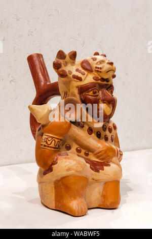 Yekaterinburg, Russia - January 17, 2019: ancient ceramic vessel in the shape of a warrior, Moche culture, AD 100-700 - Stock Photo