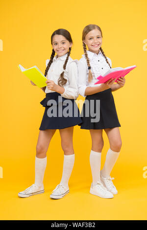 School friendship. Girl with copy books or workbooks. Study together. Kids cute students. Schoolgirls best friends excellent pupils. Schoolgirls wear school uniform. Knowledge day. School day. - Stock Photo