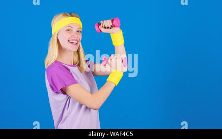Fitness instructor hold little dumbbell blue background. Fitness concept. Girl exercising with dumbbell. Workout with dumbbell. Beginner dumbbell exercises. Ultimate upper body workout for women. - Stock Photo