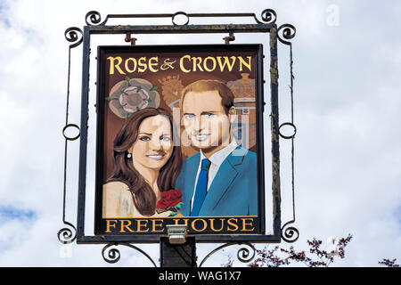 Rose & Crown free house pub sign with Will and Kate at Tilshead, near Salisbury, Wiltshire UK in August - Stock Photo