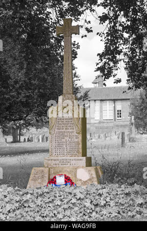 Tilshead War Memorial in churchyard of St Thomas a Becket church at Tilshead, near Salisbury, Wiltshire UK in August in monochrome with colour popping - Stock Photo