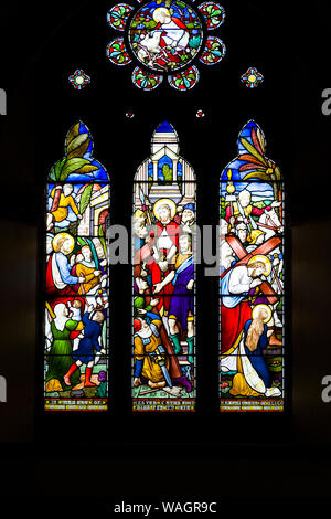 Stained glass windows in Holy Trinity Church in Westport in County Mayo Ireland - Stock Photo