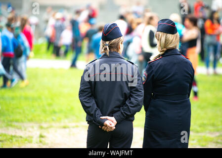 Chelyabinsk Region, Russia - June 2019: female police officers are watching the crowding. Two unidentified Russian police women in uniform monitor the - Stock Photo