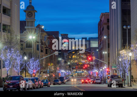 Looking down Post and Main Streets at dusk in downtown Spokane, Washington State, USA - Stock Photo