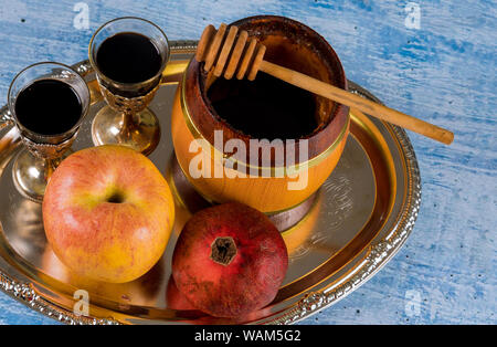 Jewish Holiday Rosh hashanah honey and apples with pomegranate traditional symbols - Stock Photo