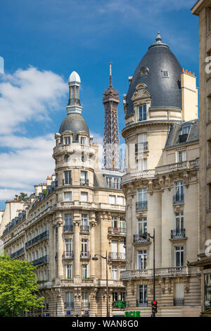 Eiffel Tower viewed through the buildings of Passy, Paris, France - Stock Photo