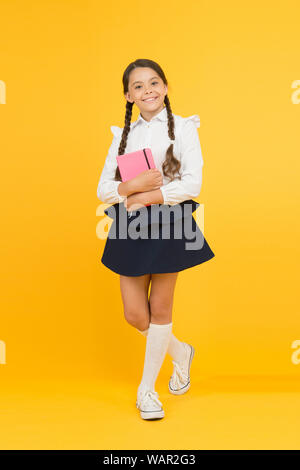 School lesson. Study literature. Towards knowledge. Learn following rules. Welcome back to school. Inspirational quotes motivate kids for academic year ahead. School girl formal uniform hold book. - Stock Photo