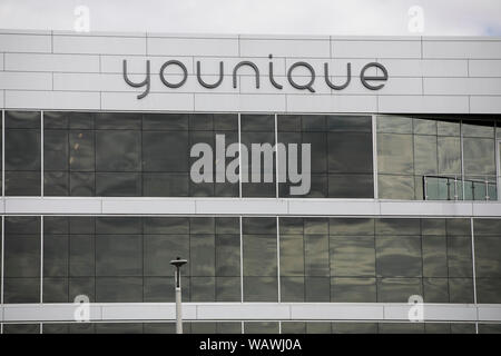 A logo sign outside of the headquarters of Younique in Lehi, Utah on July 27, 2019. - Stock Photo