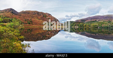 Llyn Dinas in Nant Gwynant valley near Beddgelert looking west with Moel Hebog in background Snowdonia National Park North Wales UK October 2018 - Stock Photo