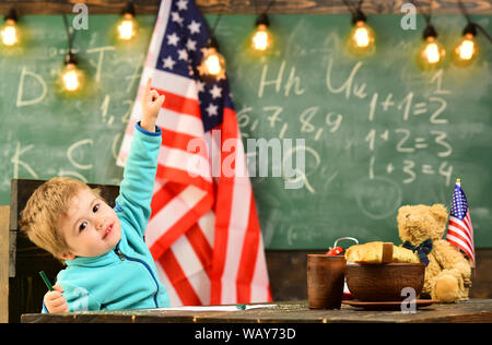 Patriotism and freedom. patritism of little kid at school with usa flag on independence day holiday. - Stock Photo