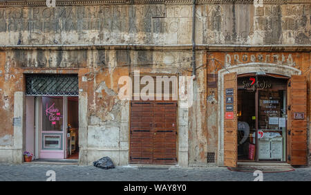 Rome, Lazio, Italy - September 1, 2017: Old facade on a lonely street in Rome - Stock Photo