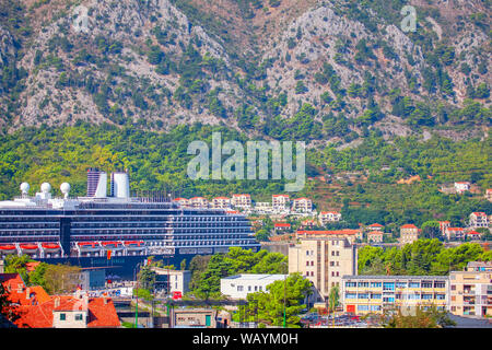 Side view of cruise ship docked in Kotor port - Stock Photo