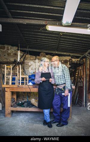 Senior couple in a carpentry - Stock Photo