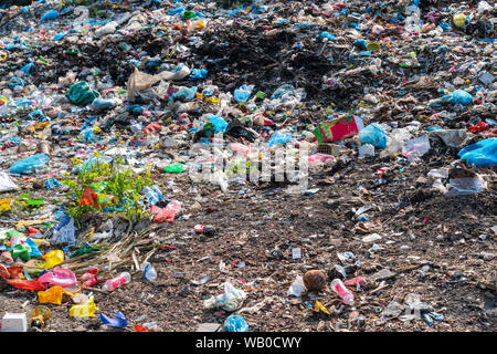 Pile of various domestic garbage in landfill - Stock Photo