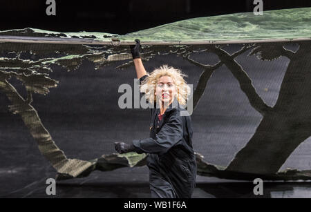 Bochum, Germany. 22nd Aug, 2019. ATTENTION: LOCK OFF TIME 23.08.2019, 22 o'clock. A member of the ensemble stands on stage in the Jahrhunderthalle Bochum during a photo rehearsal of the musical play 'Everything that happened and would happen' directed by Heiner Goebbels. Credit: Caroline Seidel/dpa - ATTENTION: Only for editorial use in the context of reporting on the Ruhrtriennale 2019/dpa/Alamy Live News - Stock Photo