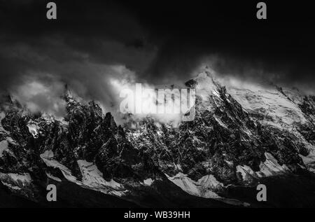 Aiguille du Midi and the Mont Blanc Massif above Chamonix, French Alps - Stock Photo