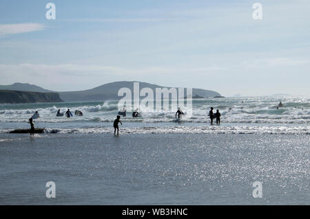 People swimming and surfing in the sea on the Welsh coast in summer July at Whitesands Bay Pembrokeshire Wales UK  KATHY DEWITT - Stock Photo