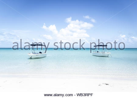 Idyllic day on a private beach on Lizard Island in Queensland, Australia. - Stock Photo