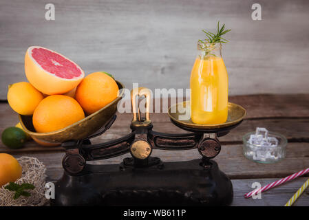 The concept of healthy eating fruits on a gray background and measuring tape as a way to combat obesity.Fighting overweight transition to a fruit diet - Stock Photo