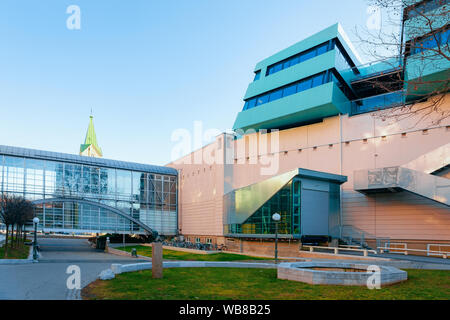 Modern office architecture with glass corridor in city of Graz in Austria. Facade of business shopping center and fitness building in town quarter in - Stock Photo