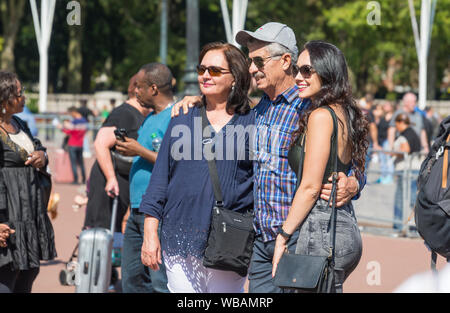 Group of tourists posing for a photo in Summer in Central London, England, UK. - Stock Photo