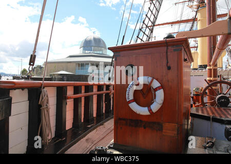"A view from Scott's ship ""RRS Discovery"" towards the Discovery Point Museum on the Dundee waterfront, north east of Scotland - Stock Photo"