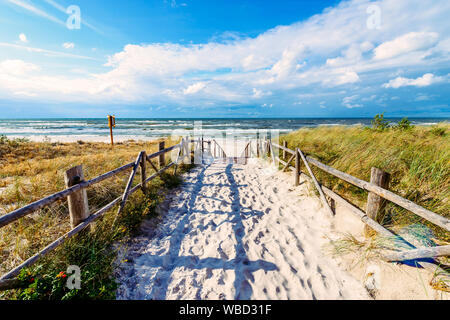 Entrance to beautiful sandy beach in Lubiatowo village, Baltic Sea, Poland - Stock Photo