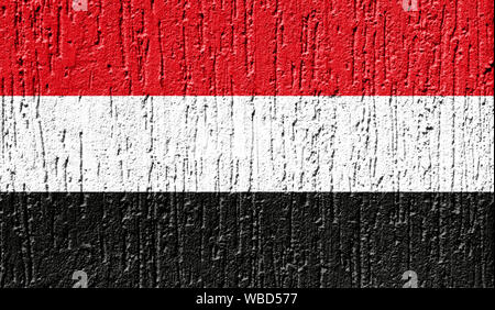 Flag of Yemen close up painted on a cracked wall - Stock Photo