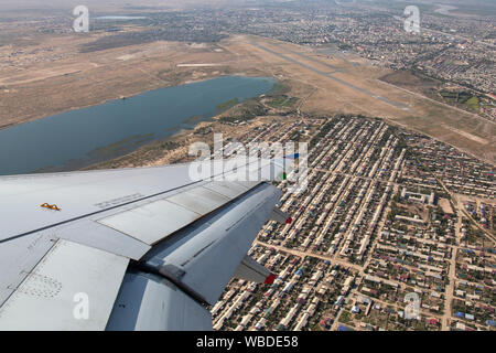 Aerial view looking down on Urgench International Airport in Uzbekistan from an aeroplane. - Stock Photo