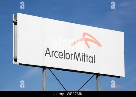 Bourg-en-Bresse, France - August 10, 2019: ArcelorMittal logo on a panel. ArcelorMittal is a multinational steel manufacturing corporation - Stock Photo