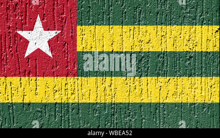 Flag of Togo close up painted on a cracked wall - Stock Photo