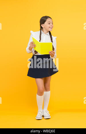 School girl formal uniform hold book. Towards knowledge. Learn following rules. Welcome back to school. School lesson. Study literature. Inspirational quotes motivate kids for academic year ahead. - Stock Photo