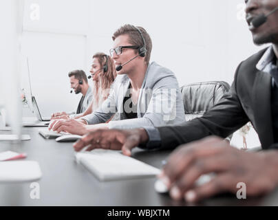 call center staff work in a modern office - Stock Photo