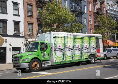 Heineken Beer delivery truck on the street in New york City. Most all Heineken Beer is brewed in Zoeterwoude, Netherlands. - Stock Photo
