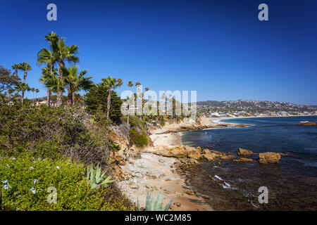 Beach view of the Pacific Ocean at Heisler Park, in Laguna Beach, California, at golden hour - Stock Photo