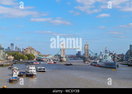 A panoramic view of the Pool of London on the River Thames with a view of the iconic Tower Bridge and HMS Belfast, viewed from London Bridge - Stock Photo